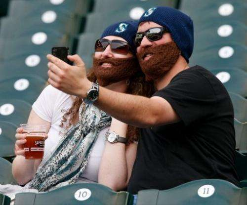 Fans take a self portrait wearing faux beards in Seattle, Washington on  26, 2013