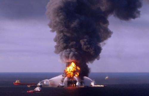 Fire boats battle the blazing remnants of the BP rig Deepwater Horizon, in the Gulf of Mexico, April 21, 2010