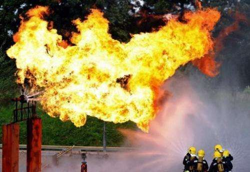 Fire-fighters extinguish a simulated gas leak during an exercise in Liverpool, England on September 7, 2010