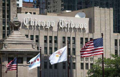 Flags fly along the Michigan Avenue bridge near the Tribune Tower, home of the Chicago Tribune, WGN Radio and the Tribune Compan