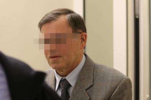 Former NATO employee identified as Manfred K arrives on November 5, 2013 at the courthouse in Koblenz, western Germany, for his