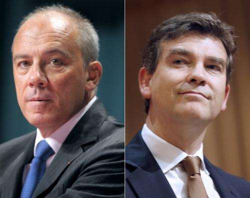 French Telecom chief executive Stephane Richard (left) and French Minister for Industrial Recovery Arnaud Montebourg