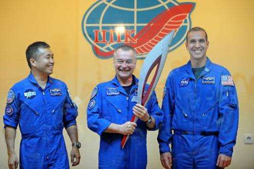 From L-R: The International Space Station Expedition 38 crew Japanese astronaut Koichi Wakata, Russian cosmonaut Mikhail Tyurin