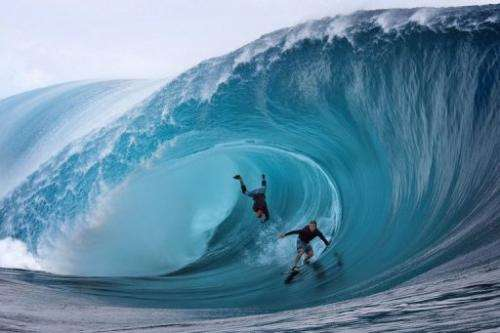 Garrett McNamara (left) and Mark Healey, both of the US, compete in a surfing event at Teahupoo, Tahiti, on June 1, 2013