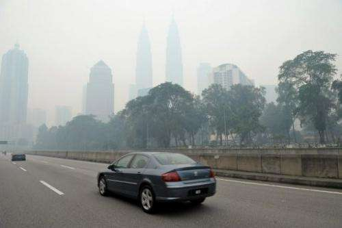Haze shrouds Malaysia's capital Kuala Lumpur, on June 23, 2013