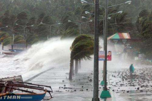 High waves pound the Filipino city of Legaspi as Typhoon Haiyan makes landfall on November 8, 2013