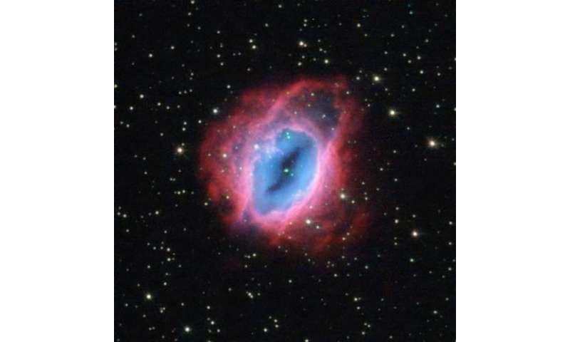 Hubble observes glowing, fiery shells of gas
