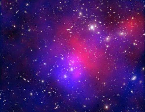 Image released on June 22, 2011 shows light exposures of galaxy cluster Abell 2744 taken by the Hubble Space Telescope