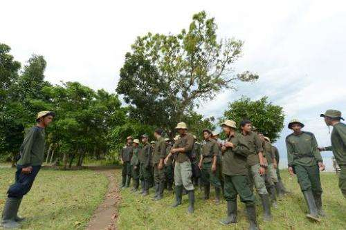 Indonesian rangers from the Rhino Monitoring Unit prepare for a 10-day monitoring trip at Ujung Kulon National Park in Banten pr