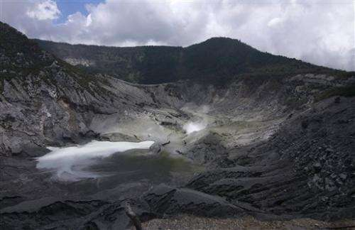 Indonesian volcano spews ash into sky; no one hurt