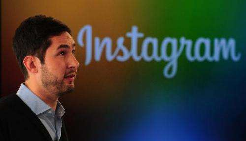 Instagram co-founder Kevin Systrom addresses a press conference in New York, December 12, 2013