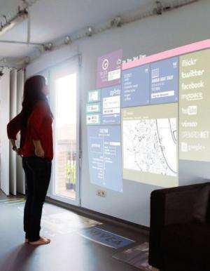 "Internet pages are displayed on the living room wall of a prototype of a ""smart home"", in Fuenterrabia, on March 4, 20"