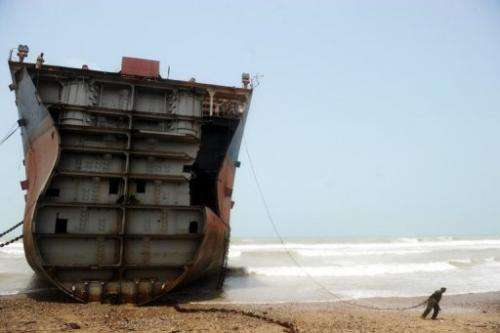 In this photograph taken on July 10, 2012, a Pakistani worker is seen in one of the 127 ship-breaking plots in Geddani