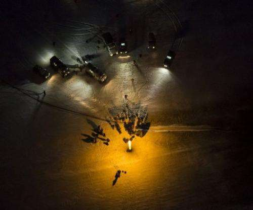 In this released NASA photo, a spacecraft is seen after it landed in a remote area in Kazakhstan on November 19, 2012