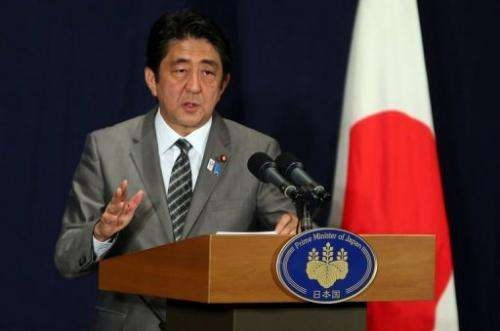 Japanese Prime Minister Shinzo Abe attends a press conference in Doha on August 28, 2013