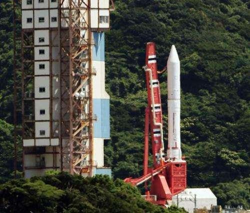 JAXA's Epsilon rocket stands on a launching pad at the Uchinoura Space Center in Kagoshima on August 27, 2013