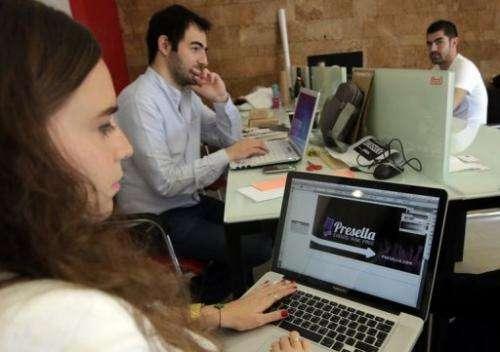 Lebanese entrepreneurs from different internet start-up companies work in Beirut on April 24, 2013