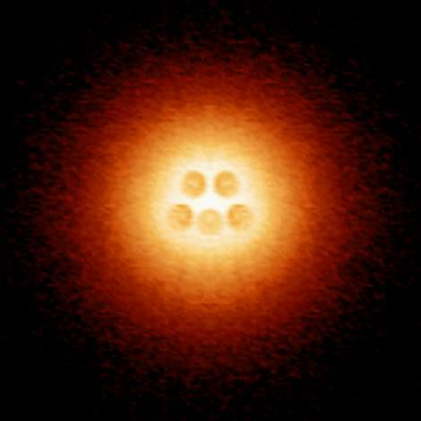 Long predicted atomic collapse state observed in graphene