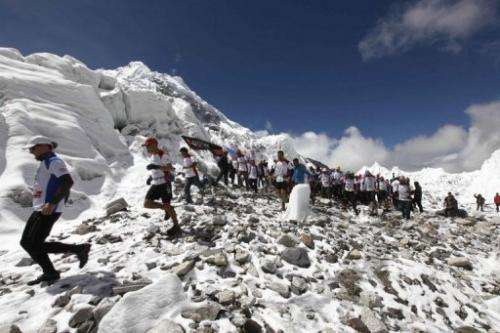 Marathon participatants are flagged off at Everest Base Camp in Nepal's Solukhumbu district, on May 29, 2013