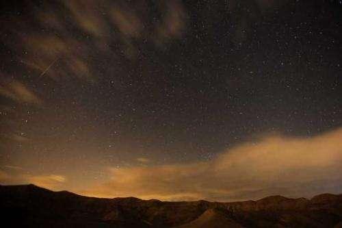 Meteor streaks are seen above the desert near the Israeli Kibbutz of Ein Gedi, early on December 14, 2012