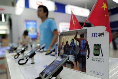 Mobile devices are displayed on a ZTE sales counter in Wuhan in central China's Hubei province on October 8, 2012