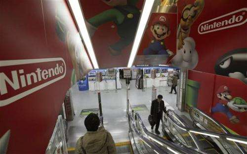 Nintendo returns to profit, lowers sales forecasts