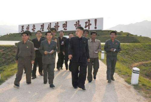 North Korean leader Kim Jong-Un visits a mushroom farm in a photo broadcast by state TV on its Facebook on June 6, 2013