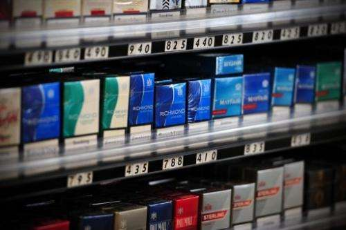Packets of cigarettes are pictured in a shop in central London on July 12, 2013