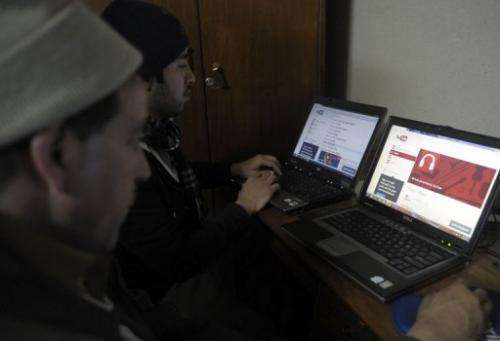 Pakistani computer users browse YouTube at an office in Quetta on December 29, 2012