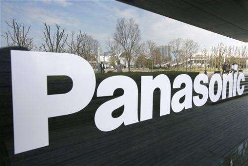 21d5fcf60cb People are reflected on the glass window of a Panasonic showroom in Tokyo  Thursday