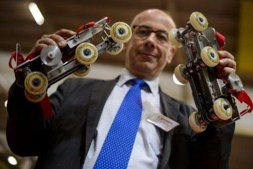 """Paul Chavand is picturd with his """"Rollkers"""" skates at the International Exhibition of Inventions on April 10, 2013"""