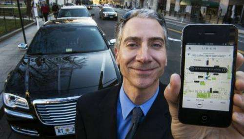 Peter Faris, CEO of Szabo Faris LLC Transportation Solutions, holds a smart phone on February 14, 2013 in Washington