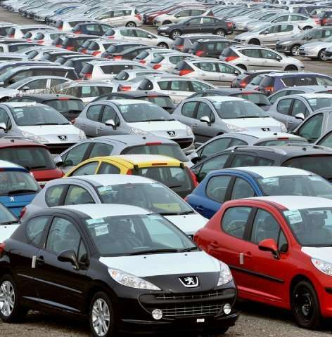 Peugeot-Citroen cars in a parking lot in Calais on March 1, 2009