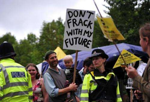 Police monitor protesters near a drill site operated by Cuadrilla Resources Ltd in Balcombe, England, on July 31, 2013