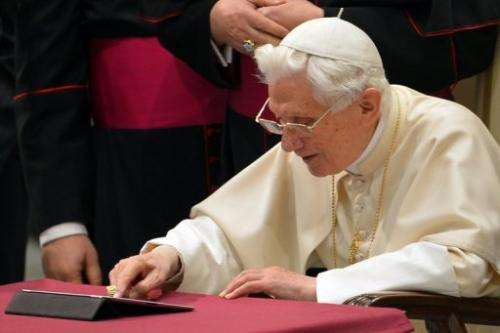 Pope Benedict XVI sends his first twitter message on December 12, 2012 at the Paul VI hall at the Vatican