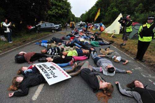 Protestors lie on the road to a drill site operated by Cuadrilla Resources in Balcombe, England, on July 31, 2013