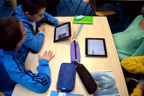 Pupils use tablets during courses in a classroom at the Leonard de Vinci 'connected' middle school in Saint-Brieuc, western Fran