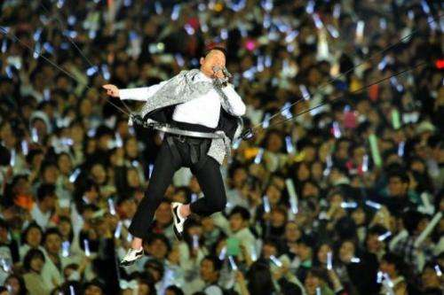 """Gangnam Style"" star Psy performs during his concert ""Happening"" in Seoul April 13, 2013"