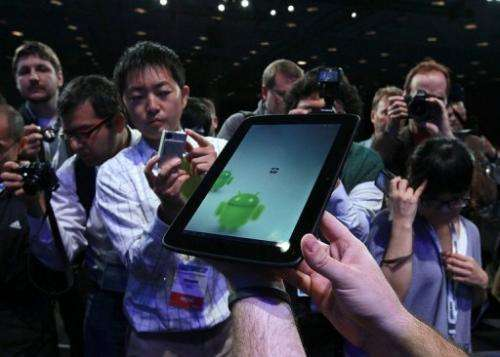 Reporters look a prototype of an Android tablet on September 13, 2011 in San Francisco