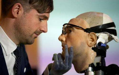 """Researcher Bertolt Meyer poses with the model for """"Rex"""", the world's first """"bionic man"""" in London on February 5, 2013"""
