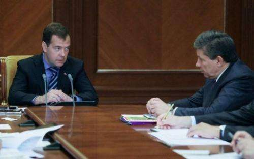 Russian Prime Minister Dmitry Medvedev (L) & Roscosmos chief Vladimir Popovkin attend a meeting, Moscow, August 14, 2012