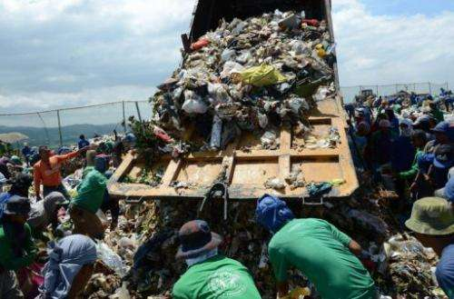 Scavengers collect recyclable materials at a temporary landfill in Payatas village, Quezon City, March 5, 2013
