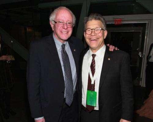Senators Bernie Sanders and Al Franken attend the 2013 Green Inaugural Ball at NEWSEUM, January 20, 2013, Washington, DC