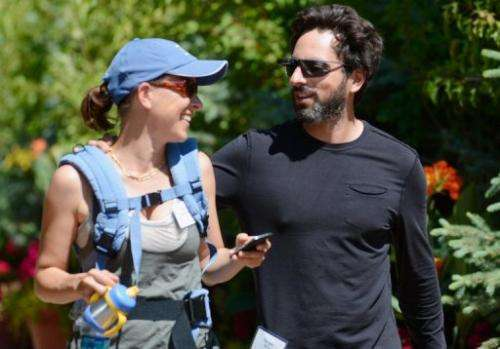Sergey Brin (R), co-founder of Google, and wife Anne Wojcicki attend a conference on July 12, 2012, in Sun Valley, Idaho
