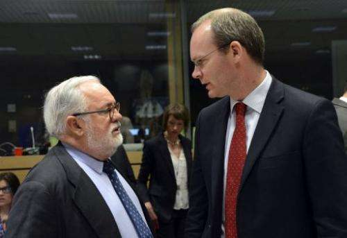 Simon Coveney (R) talks to Miguel Arias Canete in Brussels on May 13, 2013