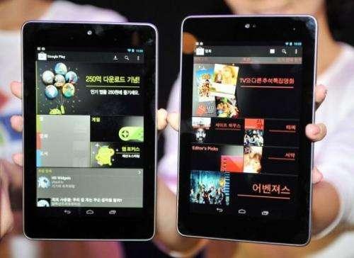 South Korean women show Google's new tablet PC, Nexus 7,  in Seoul on September 27, 2012