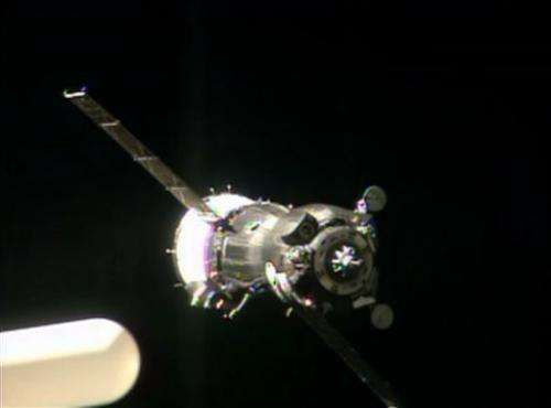 Soyuz capsule docks with space station