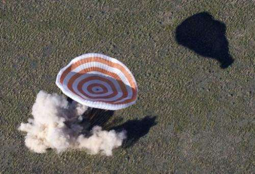 Soyuz space capsule with Tom Marshburn, Chris Hadfield and Roman Romanenko aboard lands in Kazakhstan on May 14, 2013
