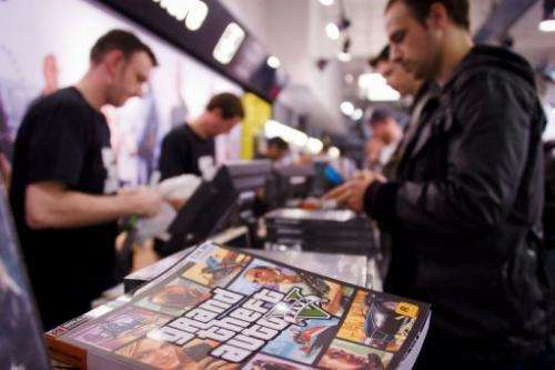 Staff sells the console game Grand Theft Auto 5 at the HMV music store in central London on September 17, 2013