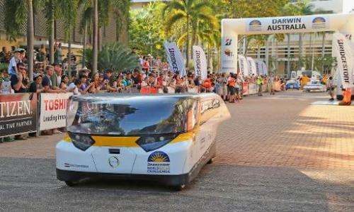 Stella from Solar Team Eindhoven crosses the start line in the World Solar Challenge in Darwin, Australia on October 6, 2013